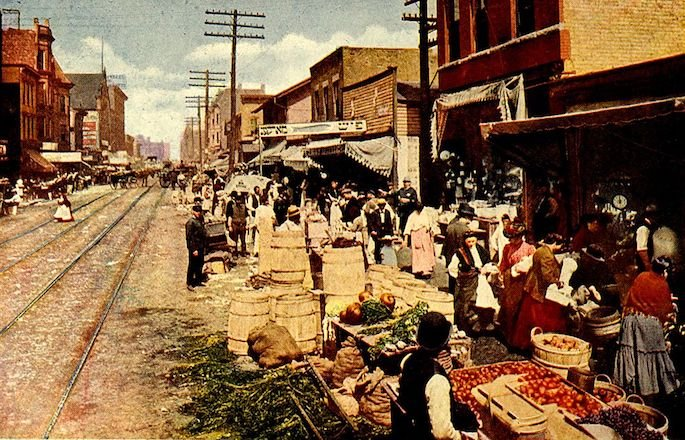 """The Jewish Ghetto of Chicago,"" from a 1915 photo of Maxwell Street colorized and printed by V. O. Hammon Publishing Company."