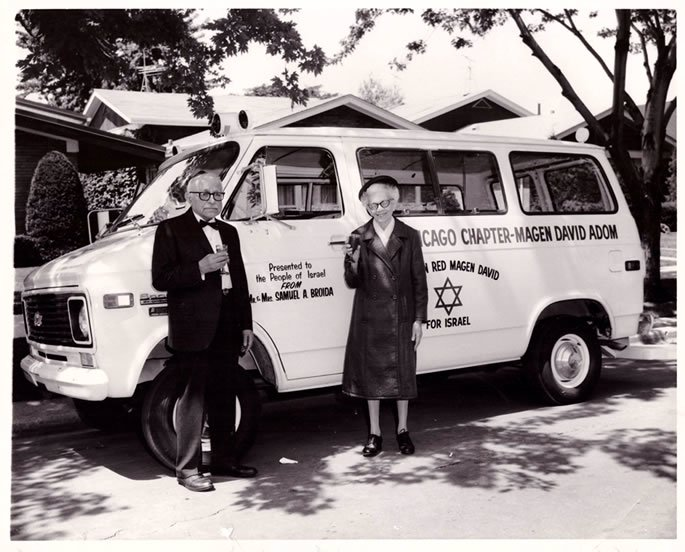 The author's grandparents, Mr. and Mrs. Broida, in front of an ambulance they donated to Israel (c. mid-60's).