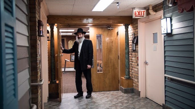 Dr. Lubin stands outside the current home of Anshei Lubavitch. (Photo: Brett Walkow)