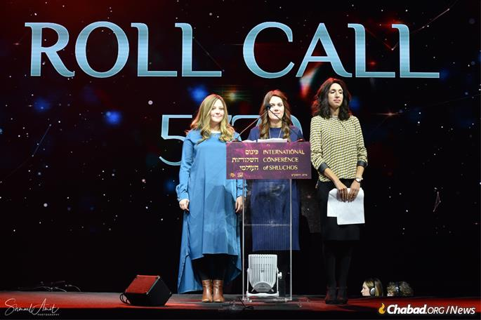 The iconic roll call of countries, territories and states represented by Chabad emissaries was led by (from left) Kiki Newman of Efrat, Israel; Mushki Bloy of Mumbai, India; and Sterna Chaikin of Worthing, Barbados. (Photo: Shmuel Amit)