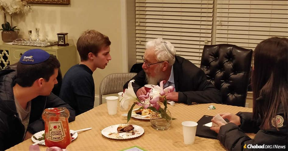 Nobel laureate Robert Aumann with students at the Rohr Chabad House at Georgia Tech and Georgia State.