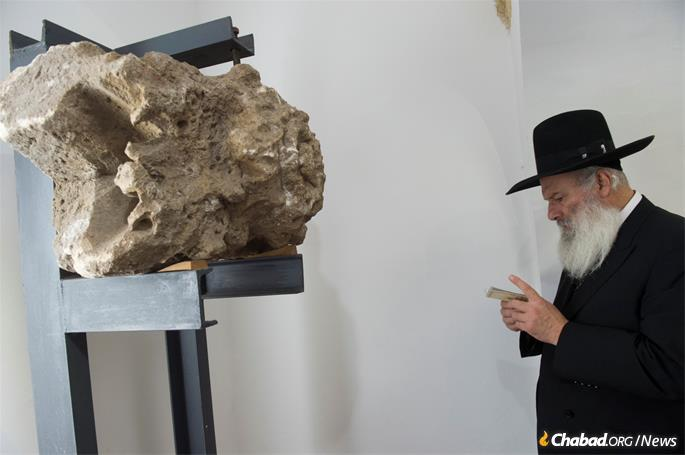 This stone was part of another ancient synagogue that had been discovered below the modern-day Buda Castle.