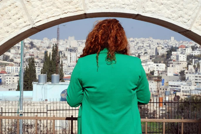 Praying at Rebbetzin Menucha Rochel's gravesite, overlooking Hebron.