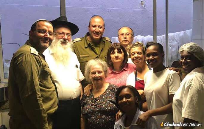 Rabbi Nissim and Rivkah Katri with Israeli aid workers and local staff.