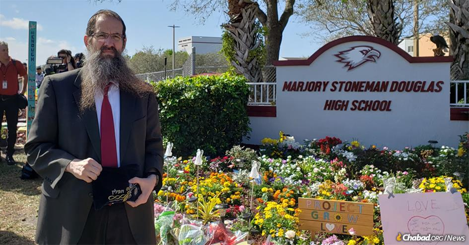 Rabbi Avraham Friedman visited Marjory Stoneman Douglas High School in Parkland, Fla., to help commemorate the one-year anniversary of the mass shooting that resulted in the deaths of 17 students and staff members.