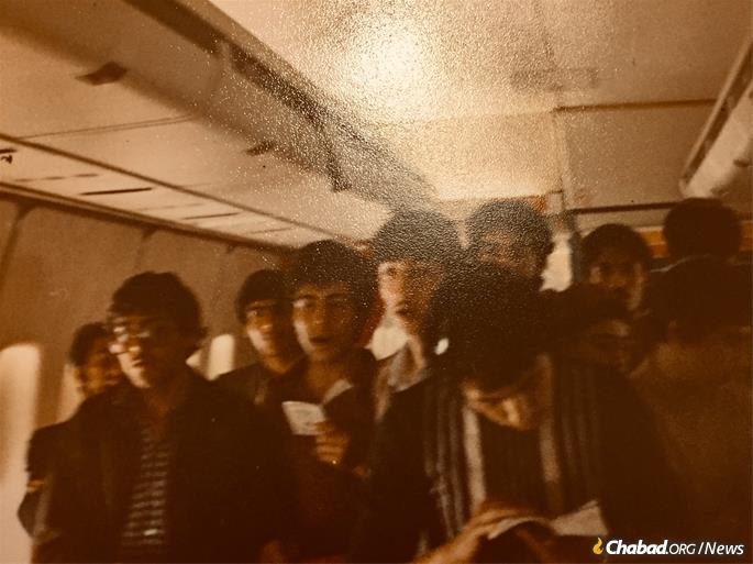 A group of Iranian boys pray on a flight from London to New York in the summer of 1980. (Photo: Courtesy of Moshe Chayempour)