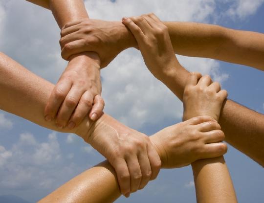 group-holding-hands-pentagon-shape.jpg