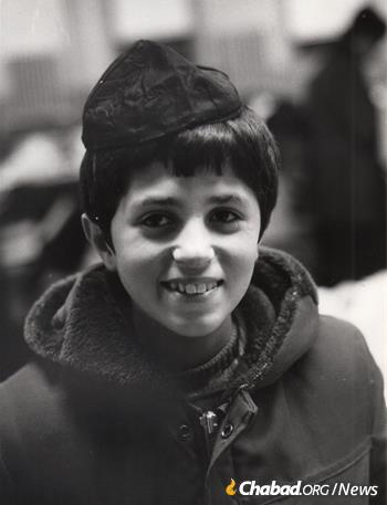 A Persian boy shortly after his arrival