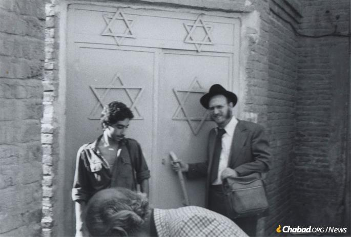 When Rabbis Sholem Ber Hecht and Hertzel Illulian first visited Tehran in August of 1978, they went hoping to establish a formal connection between Chabad and the Iranian Jewish community; revolution and refugees were the last things on their mind. Hecht at the gates of a Tehran synagogue. (Photo: Courtesy NCFJE)