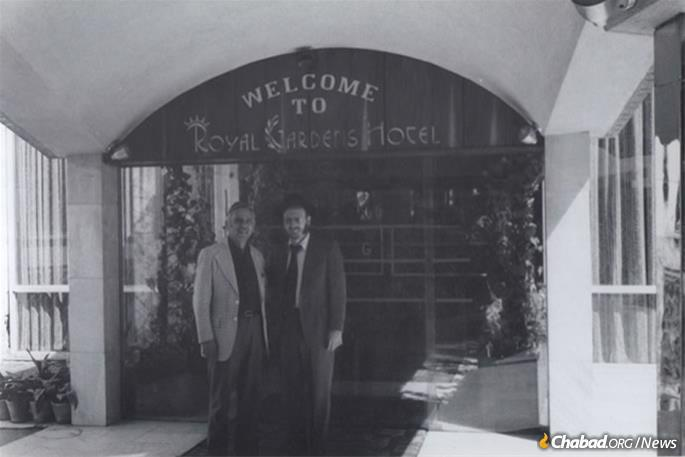 "Hecht and an Iranian Jew pose outside of the Royal Gardens Hotel. Before the revolution, the hotel was owned by the prominent Jewish Berookhim family, one of whom, Ebrahim ""Ebi,"" was arrested, accused of being a Zionist and killed by the Islamic Republic of Iran in July of 1980. (Photo: Courtesy NCFJE)"