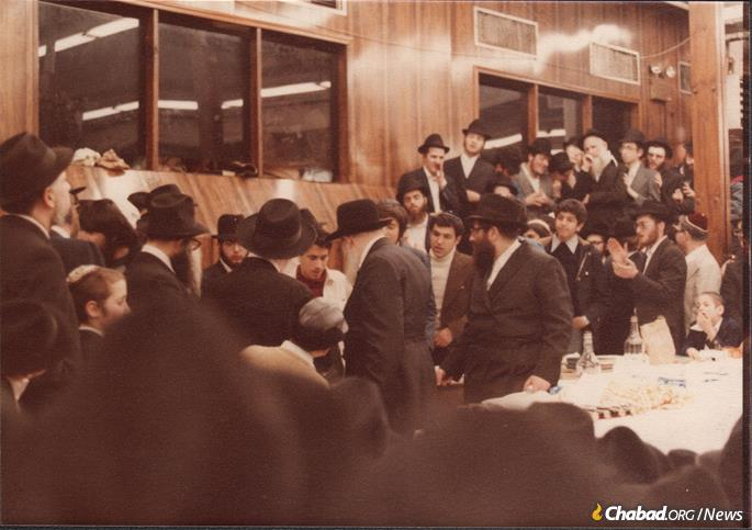 The Rebbe made a point to engage and encourage the Iranian children. For example, on Purim of 1979, the Rebbe had the Persian children seated together in a place of prominence and requested that they sing a Jewish song familiar to them. Seen here is a group of Iranian boys passing the Rebbe for Kos Shel Bracha. (Photo: Courtesy NCFJE)