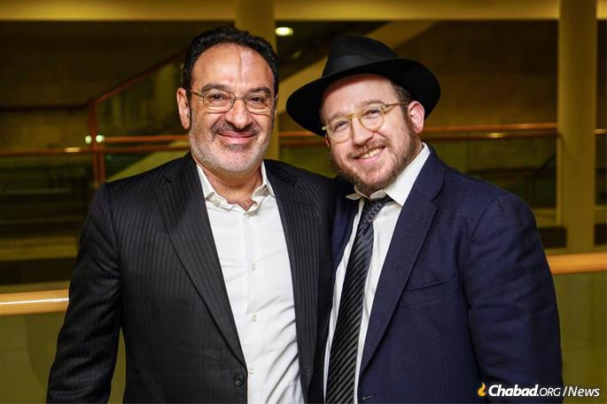 The Hebrew edition's sponsor, Eli Gurfel, left, a businessman and philanthropist residing in Thailand, with the author. Gurfel says he received comfort and support from the book following the death of his father.