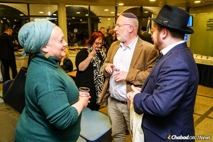 Esti Golovensitz, whose son died in an IDF training exercise in 2017, attended the event with her husband, center. Golovensitz reached out to the book's author, Rabbi Mendel Kalmenson, right, after her rabbi gave her a copy, and encouraged the author to have it translated and published in Hebrew for Israeli readers.