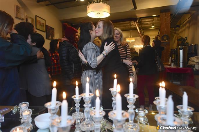 Women greet each other after candle-lighting. Photo was taken before the onset of Shabbat. (Photo: Todd Maisel)
