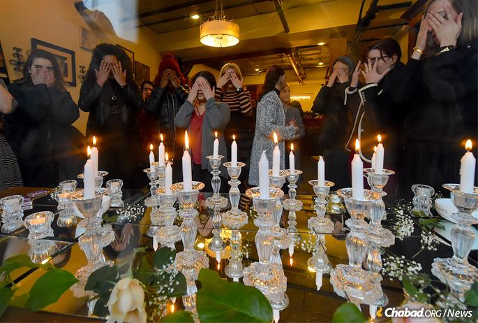 Women and girls light Shabbat candles. Photo was taken before the onset of Shabbat. (Photo: Todd Maisel)
