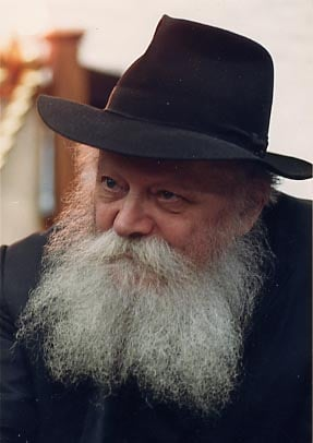 "The rebbe during the distribution of ""dollars"" in the main synagogue of Lubavitch World Headquaters, ""770"""