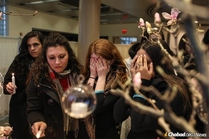 Women light Shabbat candles. (Photo: Bentzi Sasson)