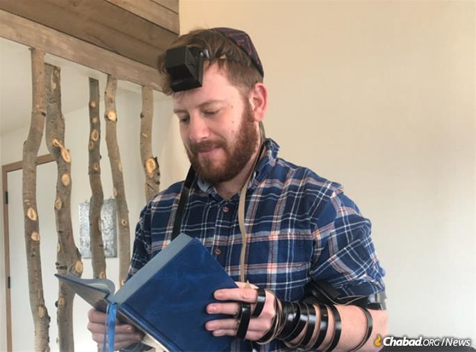 After returning home to Salt Lake City, Matt Silton fulfills his pledge to put on tefillin daily. (Courtesy: Matthew Silton)