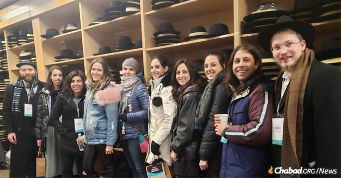 They split into five tracks for a look at the neighborhood: The Foodie, The Community Insider, The Artistic Spirit, The Scholar and The CYP Champions. One group visited Primo Hatters. (Photo: Tzemach Feller)