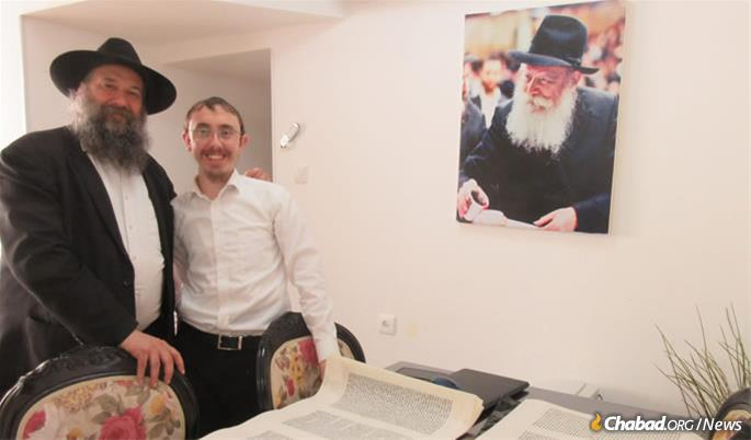 This Torah scroll is being written in Ashdod, Israel, by Rabbi Levi Butman, right, pictured here with Rabbi Mendel Moscowitz.