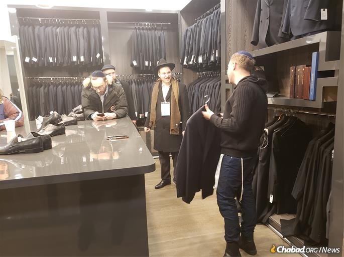 Taking measure at a local men's clothing store. (Photo: Tzemach Feller)