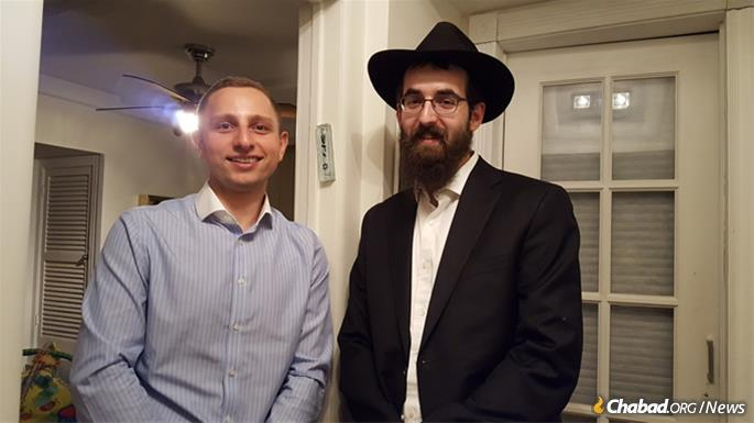 David Krainert with Rabbi Heshy Ceitlin and the newly affixed mezuzah on his Sea Gate home.