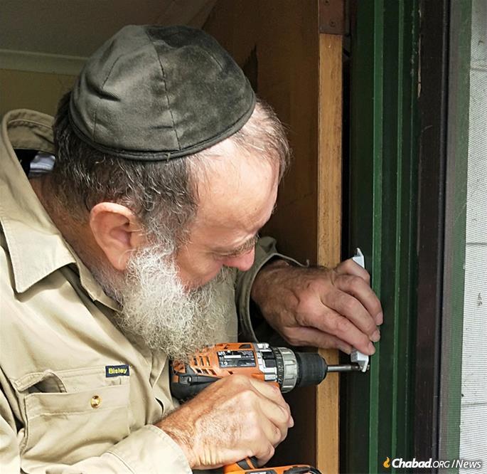Williamson then proudly affixed a mezuzah on his door.