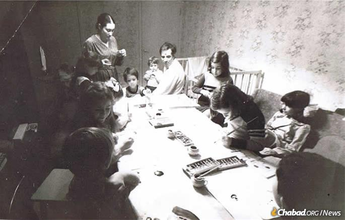 Young Dani Ash (seated at the head of the table) at a quasi-legal Jewish activity for children in Leningrad (now St. Petersburg).