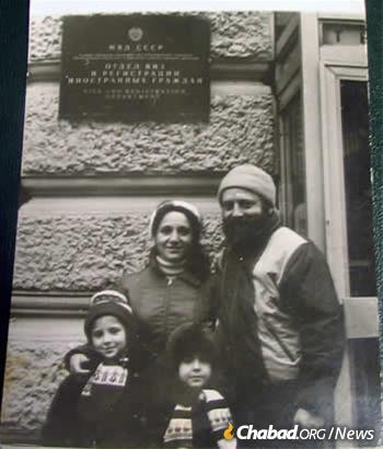 The Ash family outside of the OVIR, where they had finally been granted exit visas.
