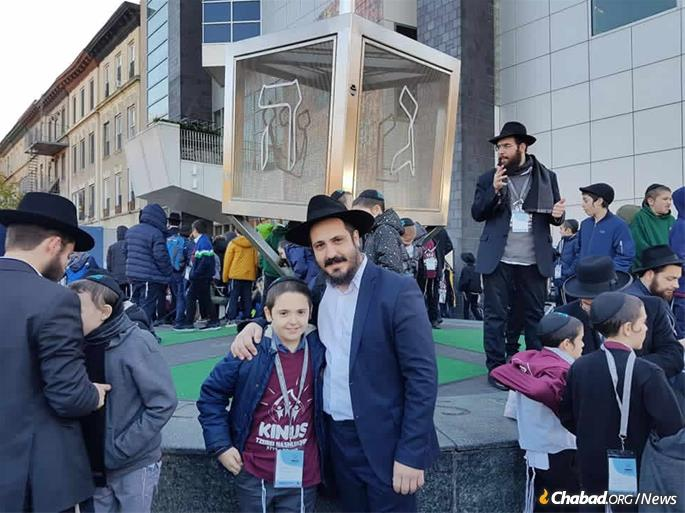 Rabbi Ash and his son at the International Conference of Chabad Lubavitch Emissaries in Brooklyn, N.Y.