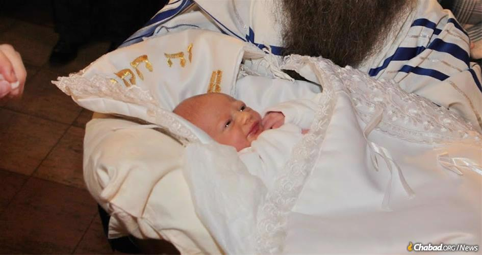 Menachem Mendel Morosov, pictured at his bris milah ceremony in Ulyanovsk, Russia, is among thousands of boys from around the world named after the Lubavitcher Rebbe. Publishers of a new book hope to chronicle every boy named after the Rebbe since his passing almost 25 years ago.