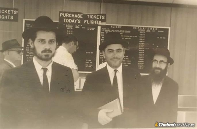 Rabbi Serebryanski with Rabbi Binyomin Klein, left, and Rabbi Chaim Gutnik, center.