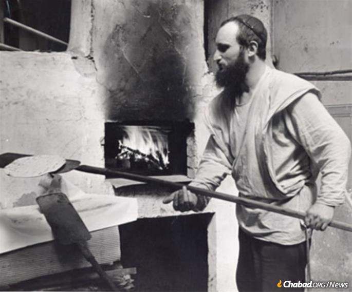 A member of the Lubavitcher yeshivah bakes matzah in France, circa 1947-48. (Photo: Archives of the American Jewish Joint Distribution Committee)