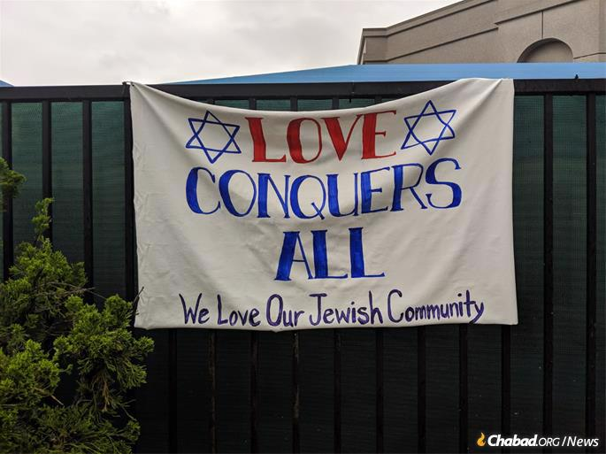 Community members put up signs and posters around the site of the attack.