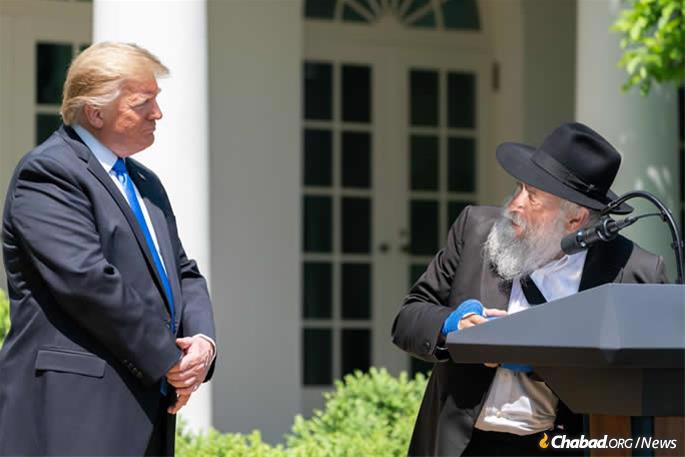 Rabbi Yisroel Goldstein thanks U.S. President Donald Trump for his support and encouragement after the shooting. (Official White House Photo by Tia Dufour)
