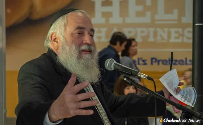 Rabbi Yisroel Goldstein speaks at a Chabad of Poway Chanukah event in December.