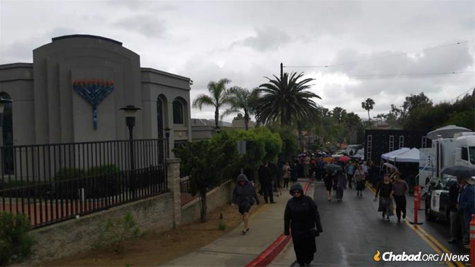 The funeral was held under rain-filled skies.