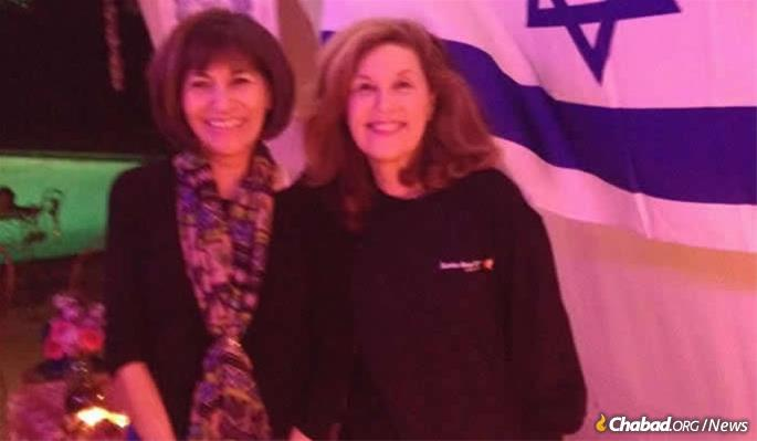 Teresa Lampert with Lori Kaye in the Kaye sukkah