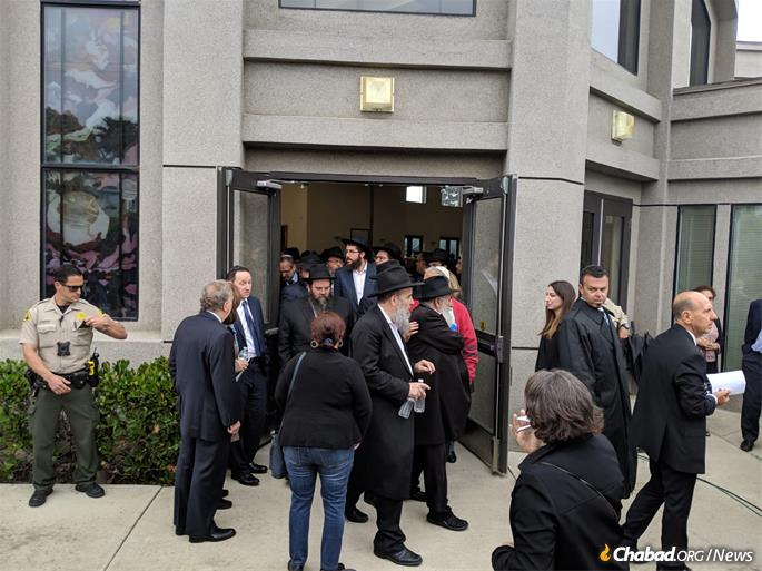 A overflow crowd of visitors filled Chabad of Poway, Calif.