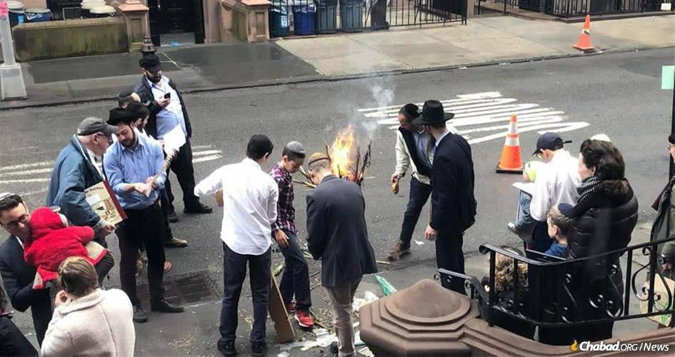 Burning the chametz last year with Chabad of Brooklyn Heights.