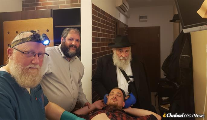 Goldstein served as sandek at the adult brit milah of a program participant.