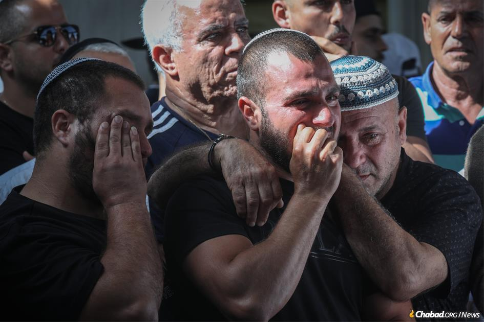 Mourners at the funeral of Moshe Agadi, a 58-year-old father of four who was killed when a rocket from Gaza struck near his home in Ashkelon. (Photo: Noam Rivkin Fenton/Flash90)