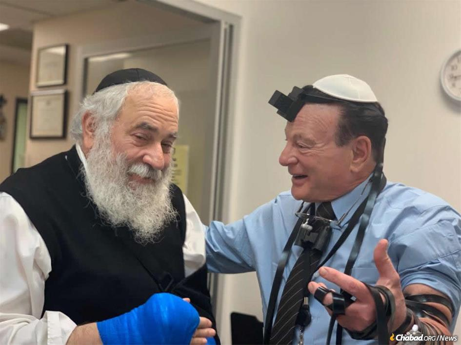 When Rabbi Yisroel Goldstein, left, learned that his surgeon, Dr. Yale Kadesky, the son of Holocaust survivors, had never put on tefillin, he offered to rectify the situation. The result: an impromptu bar mitzvah in the surgeon's office.