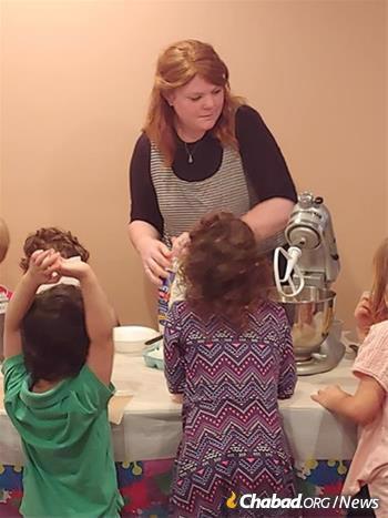 Hanna Hall teaches local kids to bake challah.