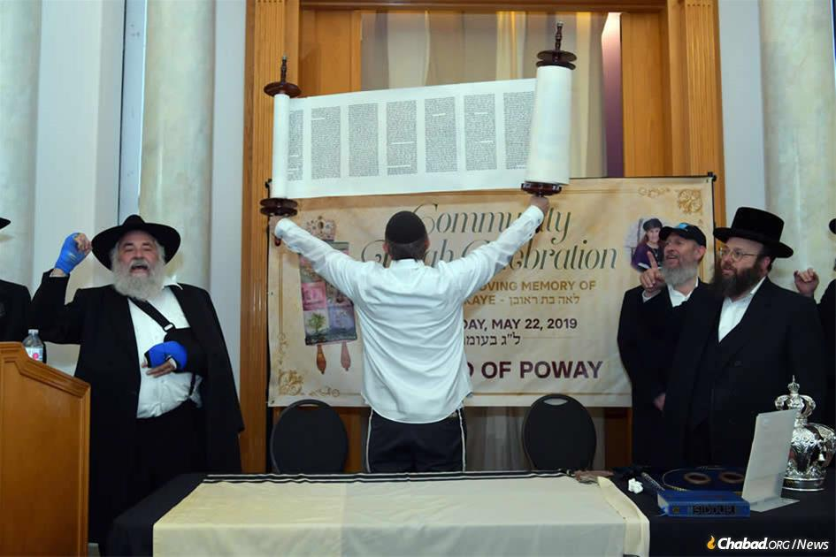 A Torah scroll was dedicated in Poway, Calif., in memory of community member Lori Gilbert-Kaye who was killed in a shooting at the local Chabad center.