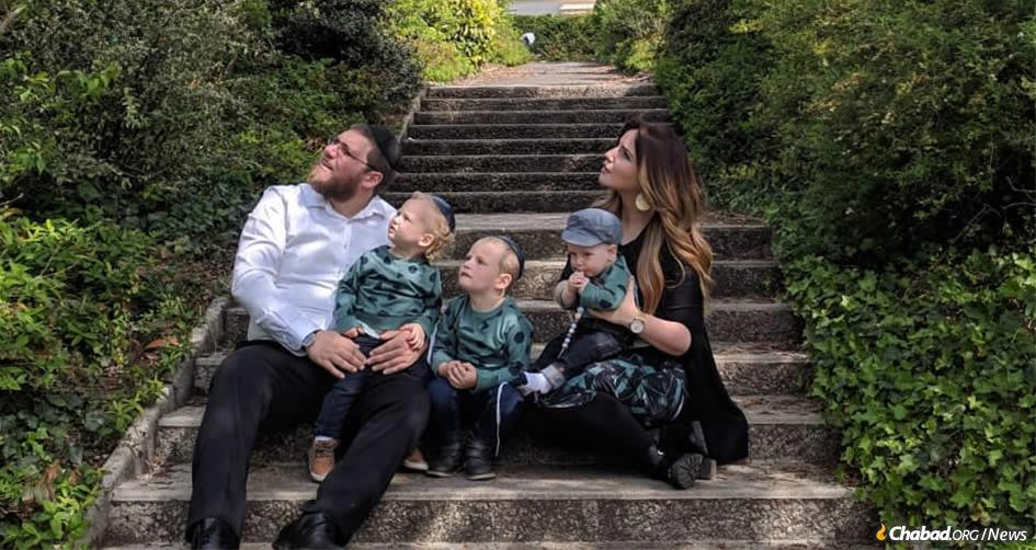 Rabbi Mordechai and Zlata Lewin, and their children, watch a military flyover in Normandy, France, site of the decisive Allied landing on D-Day that turned the tide of World War II.