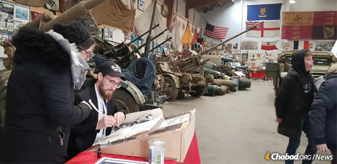 Writing letters in a sefer Torah in the local World War II military museum.
