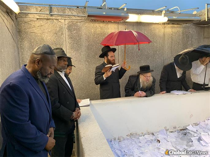 Matthew Charles at the resting place of the Rebbe, Rabbi Menachem M. Schneerson, of righteous memory, with Clive Williams.