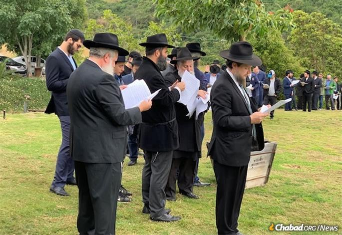 Rabbis and community members gather for the consecration of a new Jewish cemetery area in San Diego.