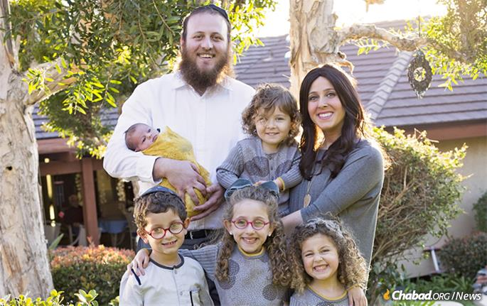 Rabbi Rafi and Chaya Andrusier, co-directors of Chabad of East County in San Diego, with their children